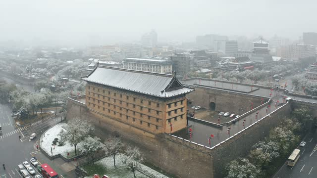 Drone view of Xi'an ancient city wall in snow,China.