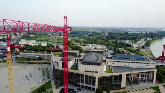 Drone view on construction site and crane - construction industry and development