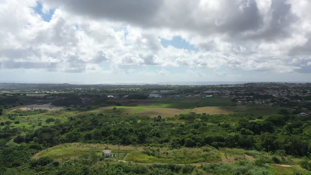 Drone view (forward) over Barbados countryside. (2) video