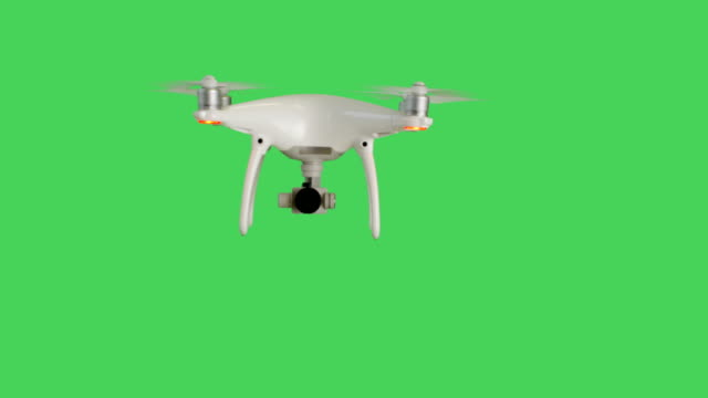 stockvideo's en b-roll-footage met drone met een vliegende camera. achtergrond is green screen. - green background