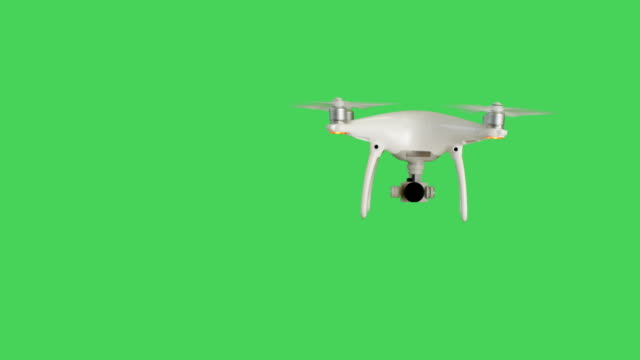 Drone with a Camera Flying. Background is Green Screen. video