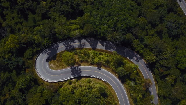 Drones: An Aerial Road Trip Aerial Shot : Endless road in a forest at Mae Hong Son, Thailand. curve stock videos & royalty-free footage