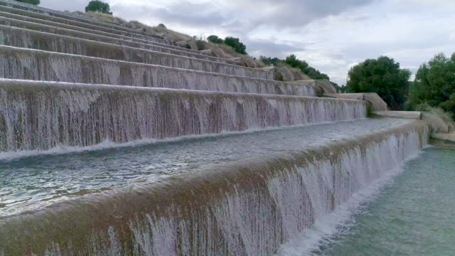 Drone's upflight on water cascade staircase