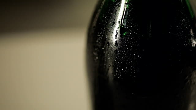 Drop of condensate drains on a bottle of champagne video