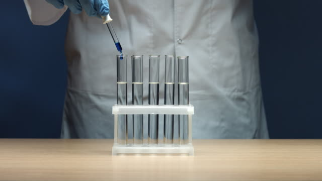 Dropping blue liquid in test tubes – Video