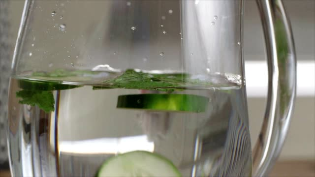 dropping cucumbers into water - cetriolo video stock e b–roll