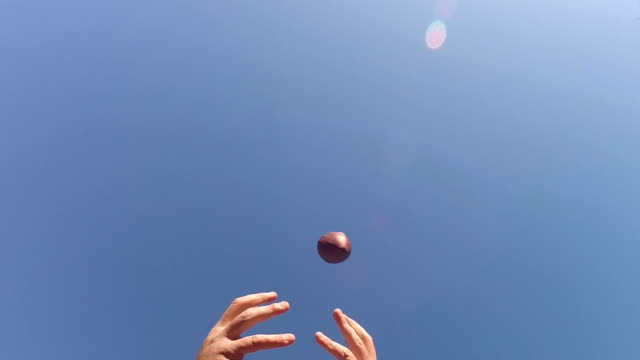 Dropping football pass in super slow motion