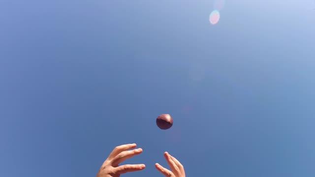 dropping football pass in super slow motion - niedoskonałość filmów i materiałów b-roll