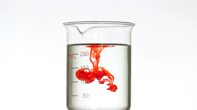 Dropping red liquid into beaker Dropping red liquid into beaker beaker stock videos & royalty-free footage