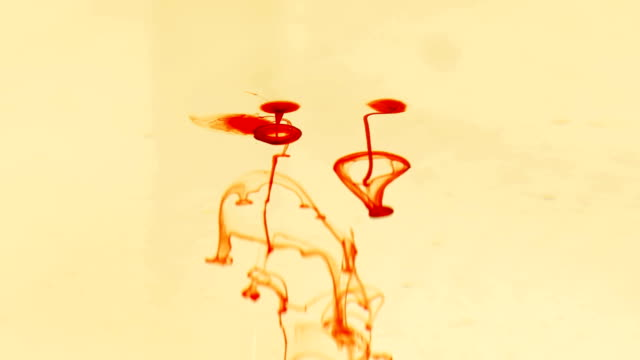 drops of red liquid similar to blood in the water video