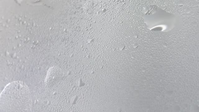 Drops of steam from hot water on misted glass 4K resolution Condensate steam from boiling water on misted glass steam stock videos & royalty-free footage