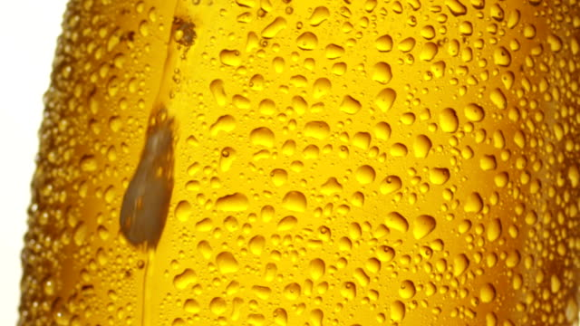 Drops sliding over beer glass video