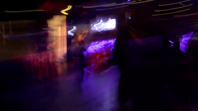 POV of drug addict person trying to walk away from night club, timelapse video