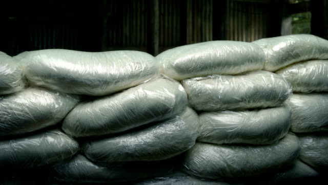 drug bags stacked up in old building - narcotico video stock e b–roll