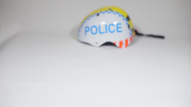 drug dealer puts weed in pack drug dealer puts weed near policemans helmet, close-up hashish stock videos & royalty-free footage