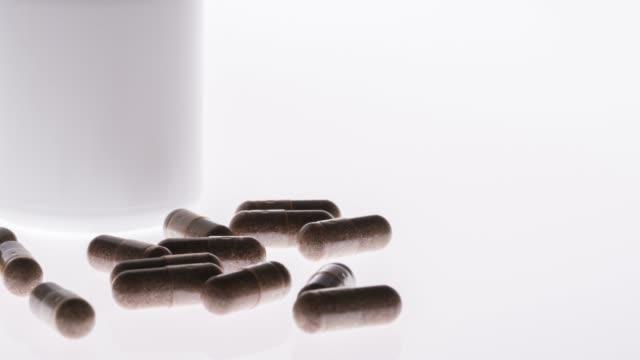 drug or medicine on the white background - disintossicazione video stock e b–roll