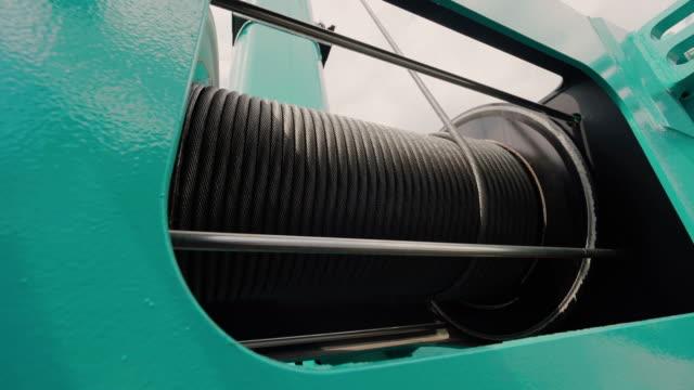 drum hoist winch. close-up of mobile crane electric drum winch. hoist drum-winch head - cavo d'acciaio video stock e b–roll