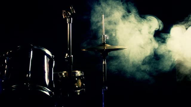 Drum set waiting on stage. Smoke