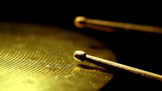 Drum sticks hitting a cymbal video