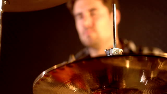 Drummer. Close-up on a unsharp male playing hard on a the snare and hi-hat of a drum kit. video