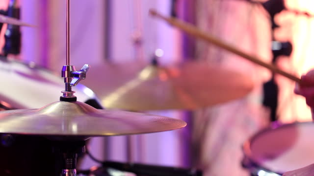 A drummer is drumming in the Studio. Plays drums with metal scores. Static video recording. A drummer is drumming in the Studio. Plays drums with metal scores. Static video recording. Close up. stick plant part stock videos & royalty-free footage