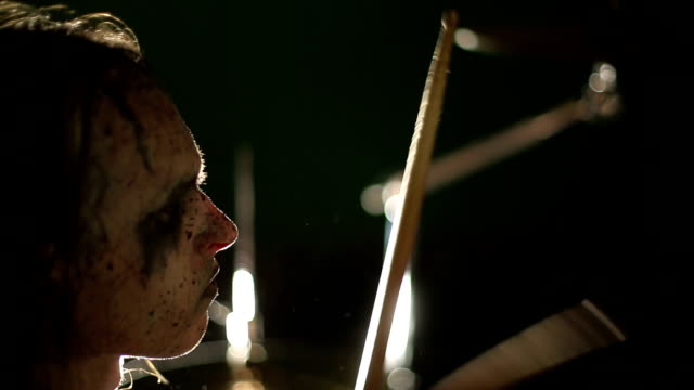 Drummer of black metal band. Close up profile face video