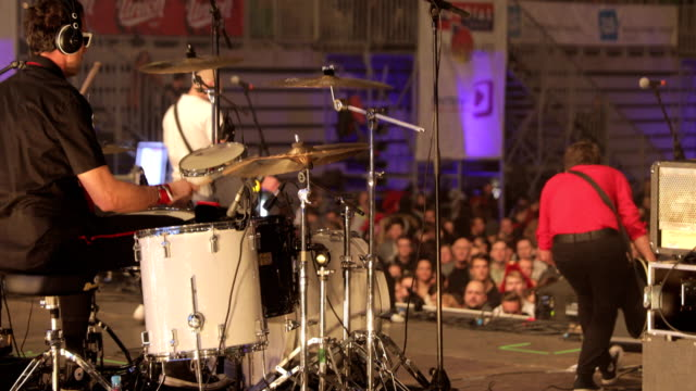 Drummer Performing on Stage