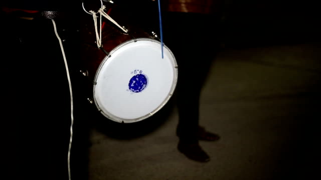 Drummer with traditional drum (Dhol)