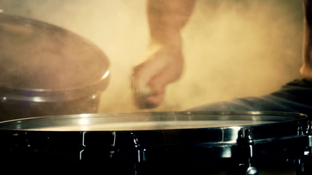 Drums hitted by a musician. Close up