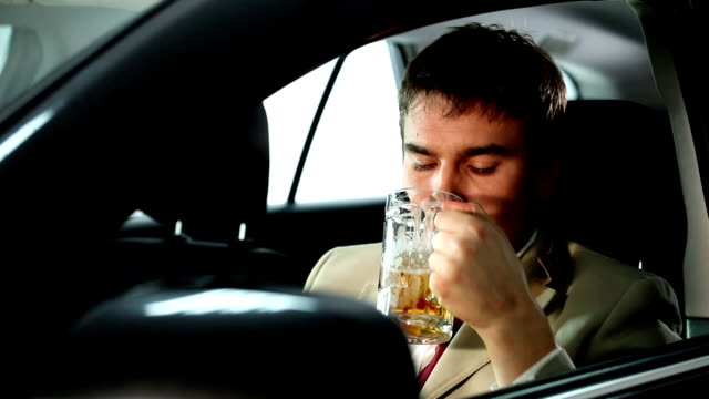 Drunk businessman in the car video