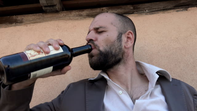 Drunk Businessman sticks to the bottle of wine video