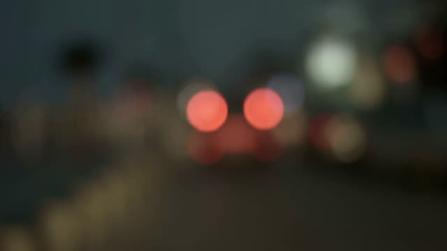 Drunk driver pov, defocused traffic lights seen through windscreen before video