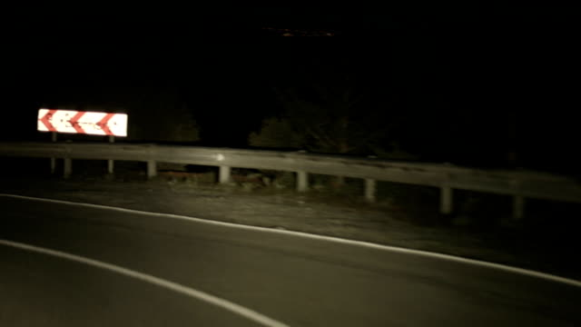 Drunk driving at night on serpentine mountain road, risk of video