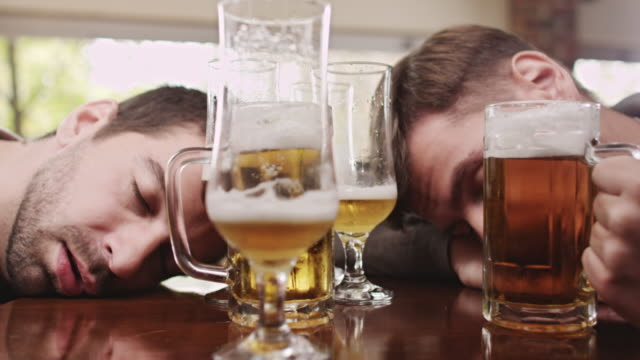 Drunk friends sleeping in a bar video