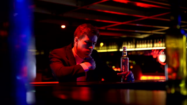 Drunk man alone stays late in bar, finishes whiskey bottle, suffering depression video