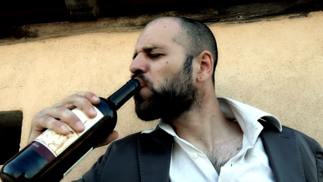 drunk man sticks to the bottle of wine video