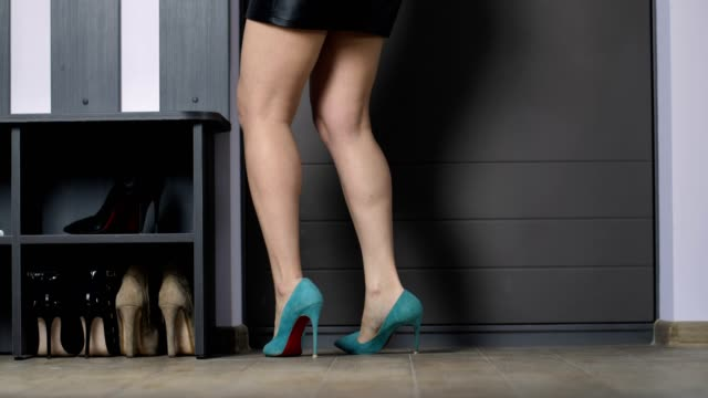 Drunk woman coming back home at night stumbling Legs of drunk woman coming back home late at night. Slim female legs in mini skirt on high heels entering door, turning on light, throwing bag and keys, walking forward stumbling in stiletto shoes tripping falling stock videos & royalty-free footage