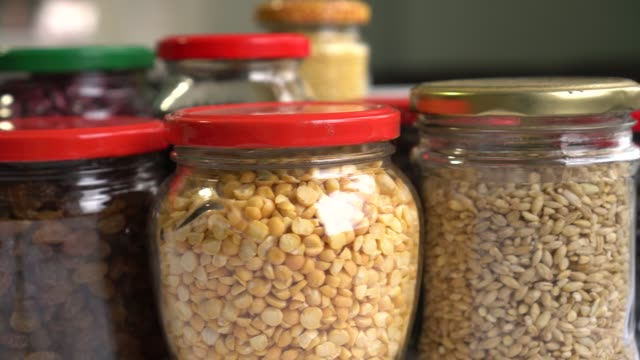 Dry Food Storage Containers. Plastic Free Pantry Dry Food Storage Containers. Plastic Free Pantry jar stock videos & royalty-free footage