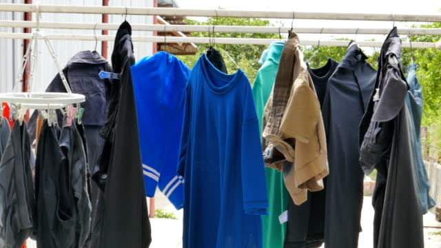 Drying clothes outdoors. Drying clothes outdoors of Southeast Asian people. laundry basket stock videos & royalty-free footage