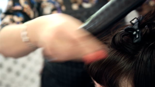 Drying hair and styling a new hairstyle. video