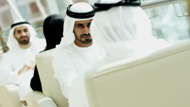 Dubai business people meeting using touch screen technology video