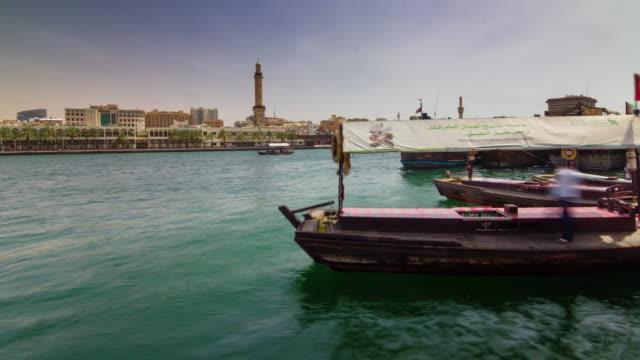 dubai city day deira creek boat ridedock panorama  4k time lapse united arab emirates - 7 star stock videos and b-roll footage