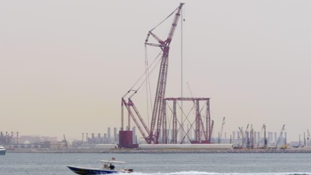 dubai city day time sea red construction crane 4k uae video