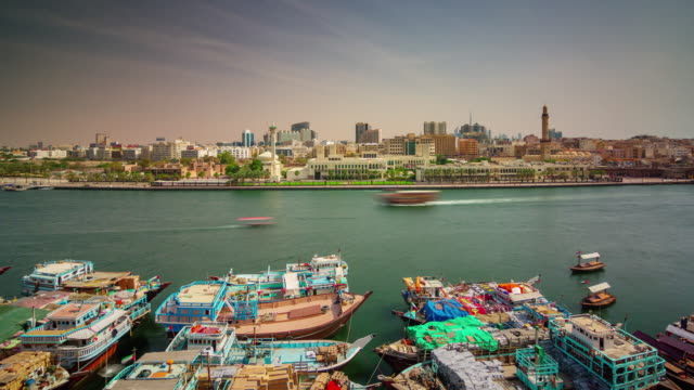 dubai city deira creek ship parking roof top panorama 4k time lapse united arab emirates - 7 star stock videos and b-roll footage