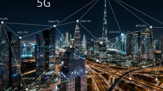T/L Dubai City Skyline and 5G Network Concept, from Day to Night / UAE