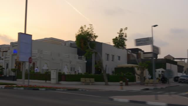 dubai city sunset time road trip side window  4k united arab emirates video