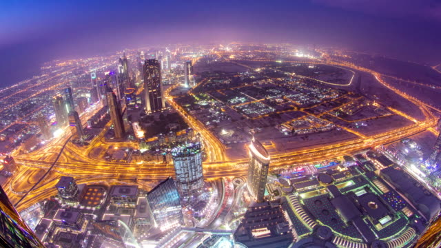 Dubai downtown from day to night transition with city lights from Burj Khalifa timelapse video