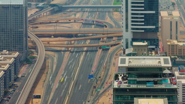 dubai hot day traffic road junction close up roof top view 4k time lapse united arab emirates video