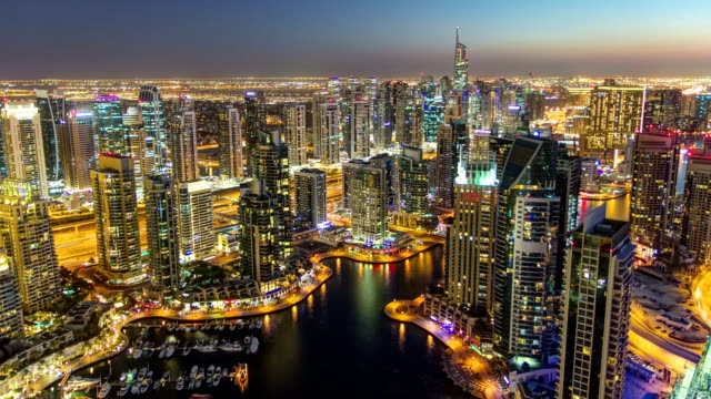 Dubai Marina with modern towers from top of skyscraper transition from day to night timelapse video