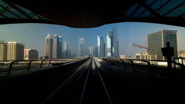 dubai metro. a view of the city from the subway car, dubai, uae. timelapse - dubai architecture stock videos & royalty-free footage